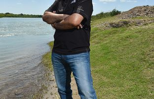 Ranch owner Salvador Salinas stands along the Rio Grande River north of Eagle Pass on April 20, 2017.