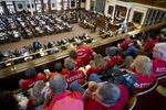 Retired Houston firefighters and their supporters watch from the state House gallery on May 6, 2017.