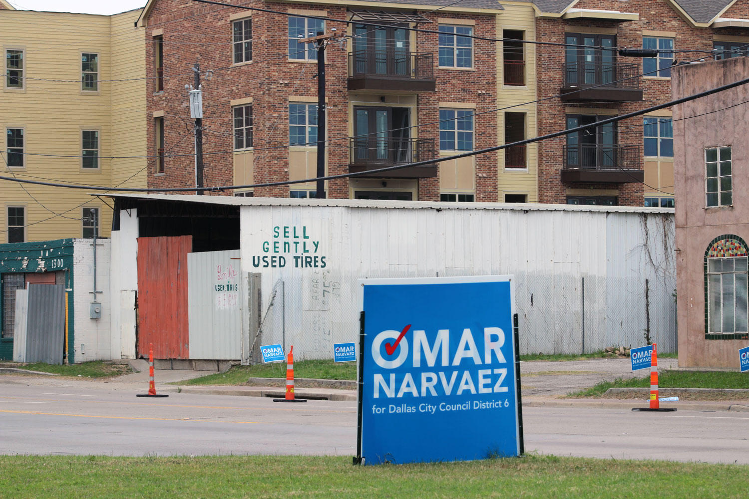 A campaign sign for Dallas City Council candidate Omar Narvaez sits along Singleton Boulevard in West Dallas. Narvaez is facing incumbent Monica Alonzo in a runoff next month in a part of the city where officials suspect mail-in voter fraud may have occurred.