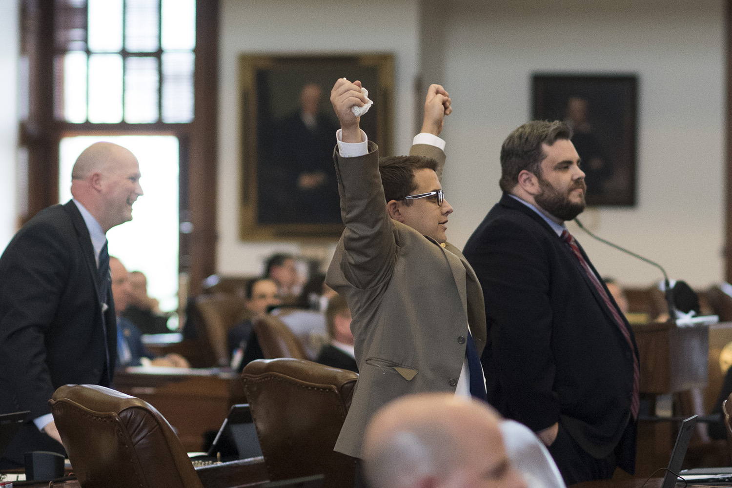 State Rep. Briscoe Cain, R-Deer Park, raises his arms in celebration as he and other members of the so-called Freedom Caucus killed more than 100 bills.