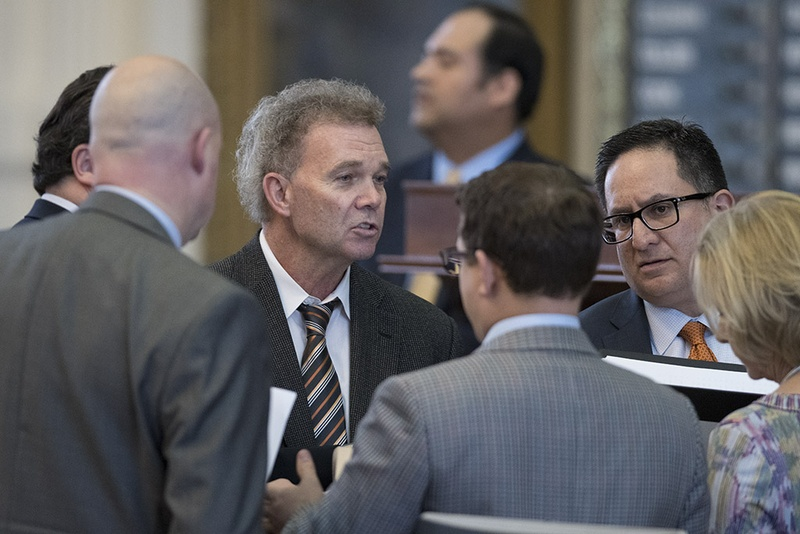 State Reps Joe Pickett, D-El Paso, and Larry Gonzales, R-Round Rock, negotiate with House members with amendments to SB 312, the Texas Dept. of Transportation sunset bill on May 16, 2017. Pickett is a member of the House transportation committee and Gonzales is overseeing sunset legislation.