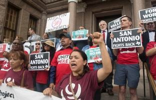 Protesters express their opposition to Senate Bill 4 — the sanctuary cities bill — on the south steps of the state Capitol on May 16, 2017. The bill which takes effect Sept. 1st.