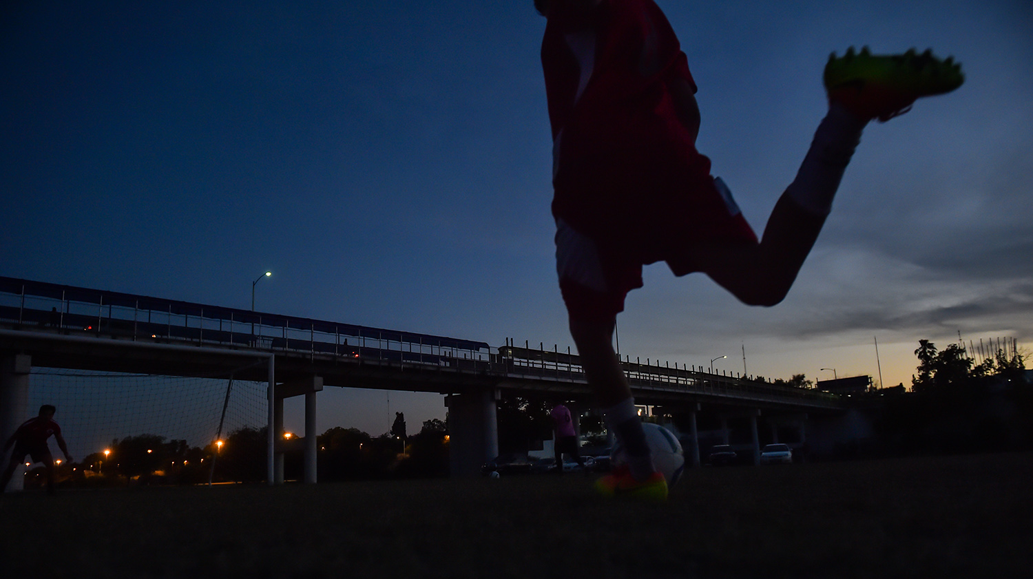 A soccer player on the Twin Cities FC team practices at a municipal park in Eagle Pass. Soccer players are concerned that a new wall could run through the city's only public soccer field.