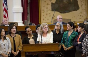 State Rep. Donna Howard, D-Austin, is surrounded by fellow lawmakers as she speaks about Senate Bill 8, which would change how abortion providers handle fetal tissue, on May 19, 2017.