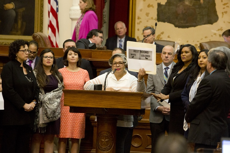 "During a debate on the ""bathroom bill,"" state Rep. Senfronia Thompson, D-Houston, holds up a photo of a sign that reads, ""RESTROOMS WHITE COLORED,"" on May 21, 2017."