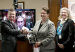 Commissioner Steven Weinberg attended the Texas Alcoholic Beverage Commission's quarterly meeting via video conference on May 23, 2017. Weinberg quit the day of the meeting. Chairman Kevin Lilly, left, alongside Commissioner Ida Clement Steen, right, recognized Carla Thompson with a promotion to Captain.