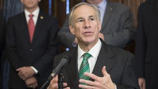 Gov. Greg Abbott signs a bill that cracks down on inappropriate student-teacher relationships on May 25, 2017.