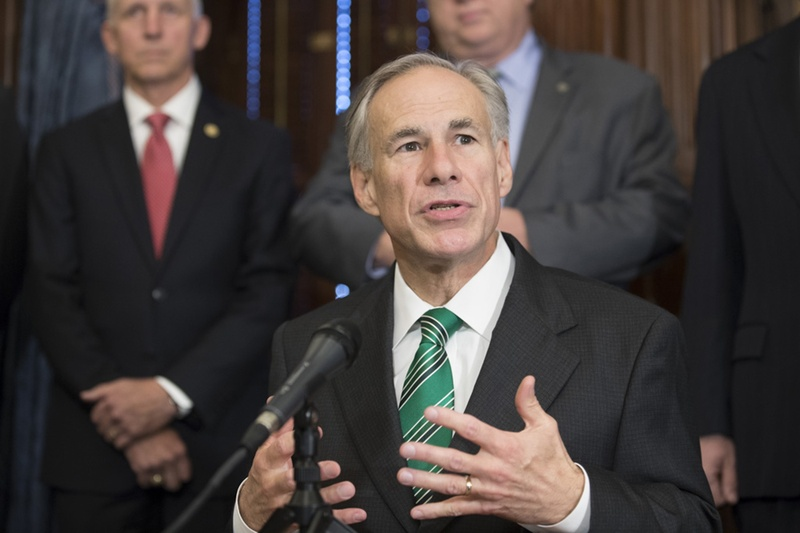 Gov. Greg Abbott signs a bill thatcracks down on inappropriate student-teacher relationships on May 25, 2017.