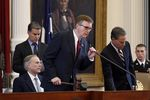 Gov. Greg Abbott, Lt. Gov. Dan Patrick and Speaker of the House Joe Straus on the dais in the House chamber for a joint session memorializing the nation's veterans, on May 27, 2017.