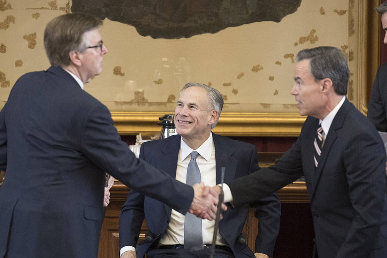 Gov. Greg Abbott looks on as Lt. Gov. Dan Patrick, left, and House Speaker Joe Straus shake hands on Saturday.