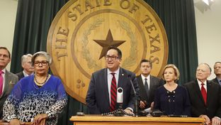 Flanked by fellow lawmakers from the House, State Rep. Larry Gonzales, R-Round Rock, speaks at a press conference on May 28, 2017.