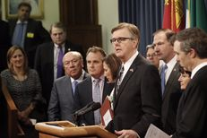 Surrounded by senators, Lt. Gov. Dan Patrick talks to reporters on May 29, 2017.