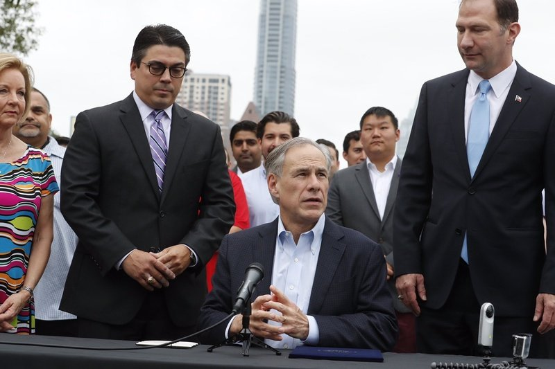 At an outdoor bill-signing ceremony in Austin Gov. Greg Abbott tells reporters he'll make an announcement on a special session later this week.&nbsp