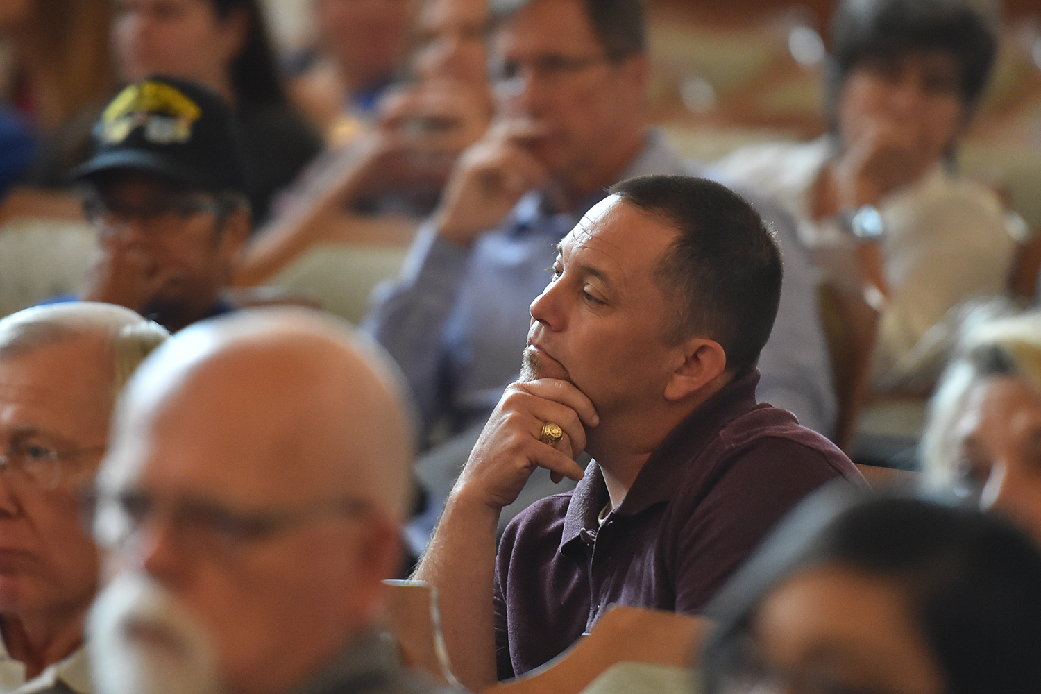 Local activist Mike Stewart listens during a Texas House Committee on Defense and Veterans' Affairs hearing on how annexation reform might affect nearby San Antonio military bases. The hearing was held in the San Antonio City Council chambers on June 19, 2017.