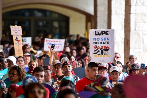"""People demonstratingagainst Senate Bill 4, the """"sanctuary cities"""" ban, march near the Riverwalk in San Antonio on June 26, 2017. U.S. District Judge Orlando Garcia is hearing opening argumentsfrom Texas cities and counties challenging the measure, signed into law by Gov. Greg Abbott."""