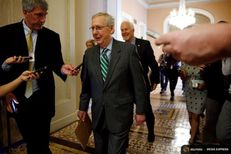 Senator Majority Leader Mitch McConnell and Senate Majority Whip John Cornyn are trailed by reporters as they walk to the Senate floor of the U.S. Capitol after unveiling a draft bill on healthcare in Washington on June 22, 2017.
