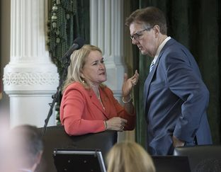 State Sen. Sylvia Garcia, D-Houston, talks with Lt. Gov. Dan Patrick on the dais during the Senate session on July 19, 2017.  After passing SB20 the sunset bill, the Senate will reconvene at midnight to pass the bills to third reading.