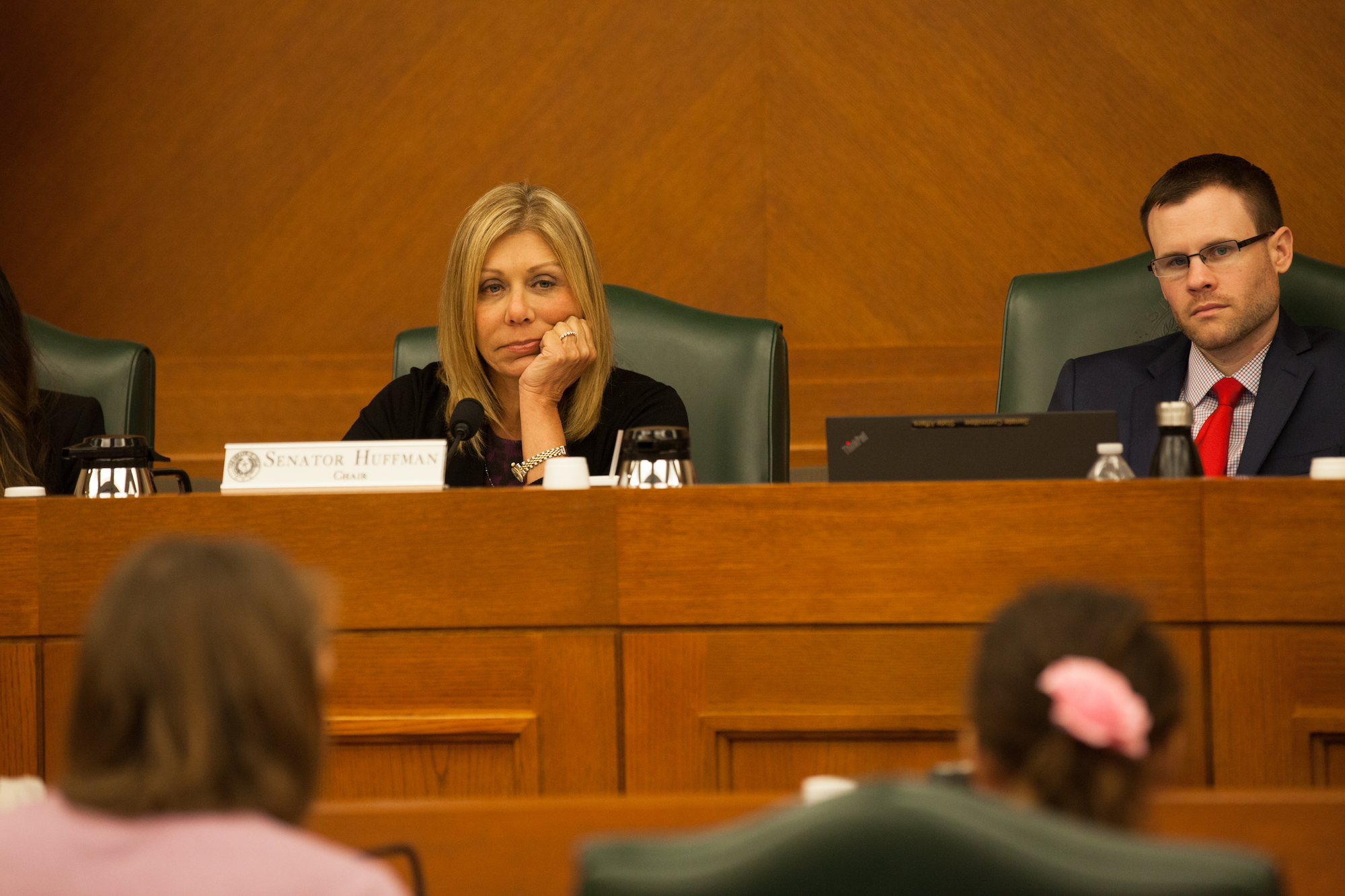 State Sen. Joan Huffman, R-Houston, listens to Libby Gonzales speak against SB 3 and SB 91 before the Senate State Affairs Committee on July 21, 2017.