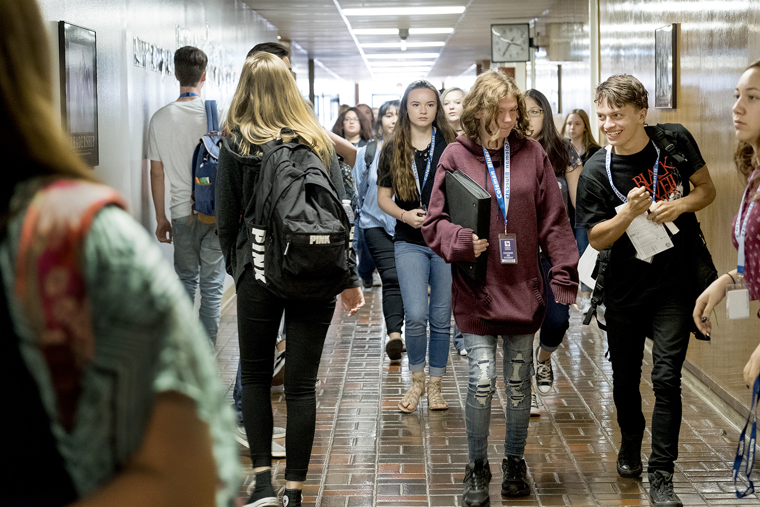 Students fill the hallway as school lets out on the first day of the school year at Coleman High School on August 24, 2017.