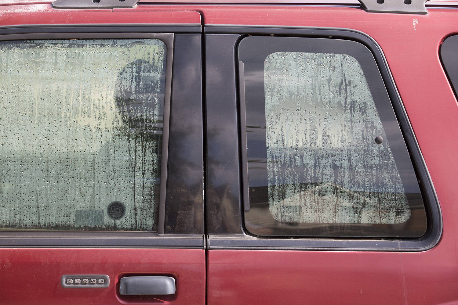 The windows of Eddie Rogers' flooded Ford Explorer steam up on the inside.