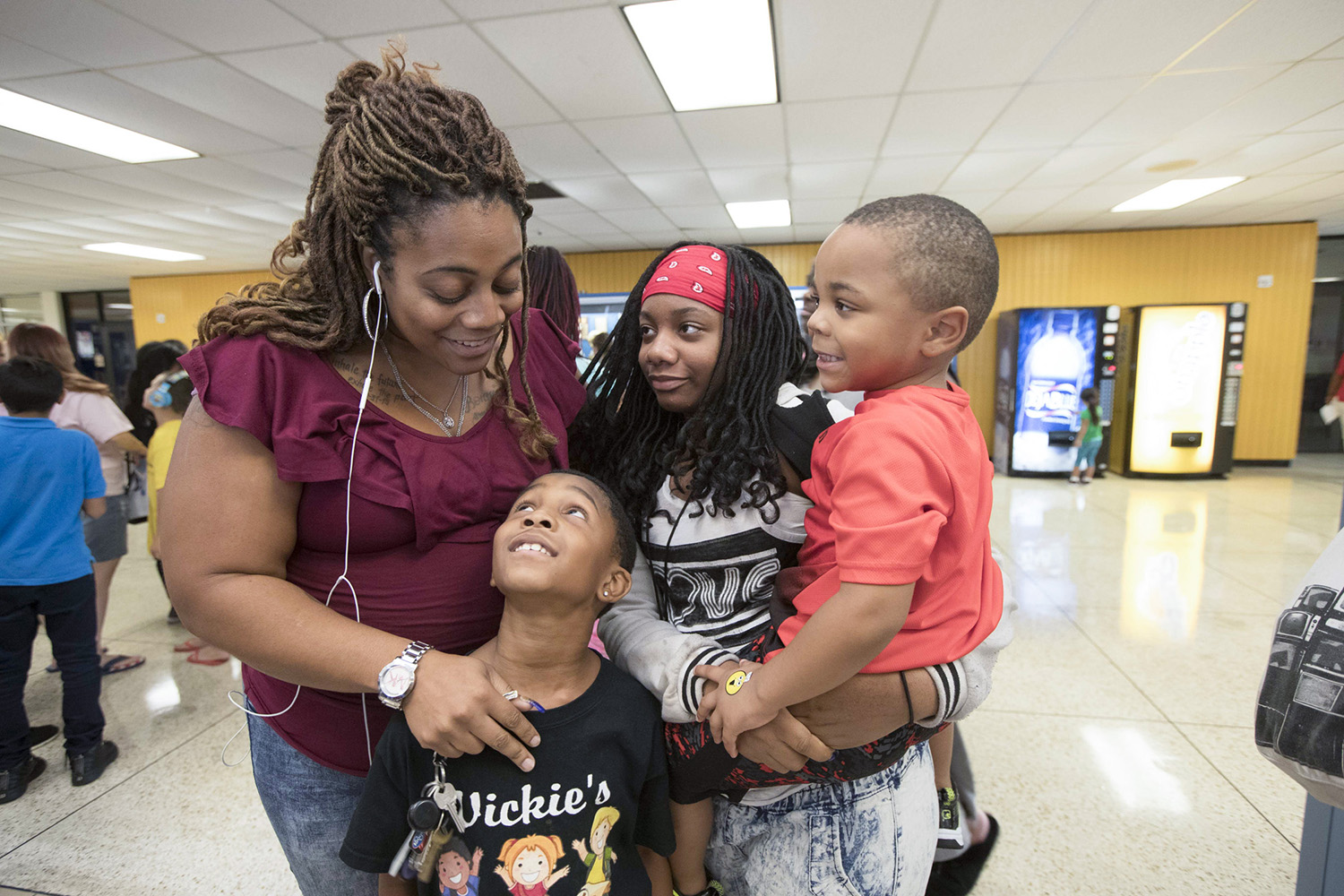 Opposed to Texas City ISD's relocation plan, Monique Lazard, at left, will re-enroll her 11-year-old daughter in a different school district.