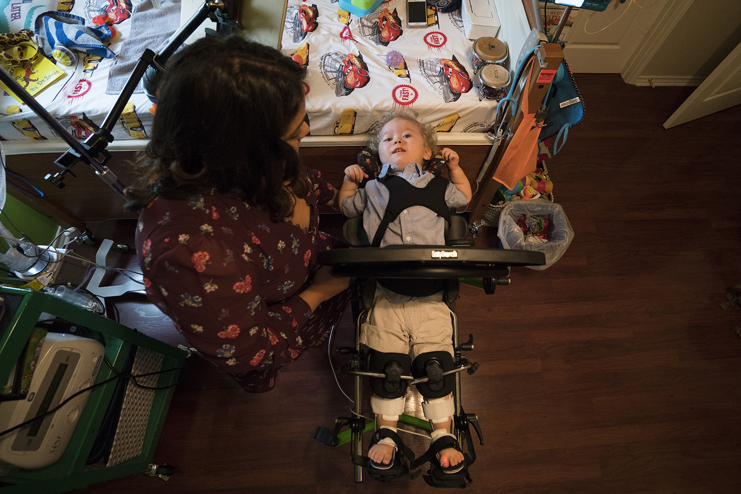 Kristen Resendez of Harlingen places her son, Jack, in a pediatric standing frame in their home in Harlingen, Texas. Jack has spinal muscular atrophy, costing him the ability to use most of his body.