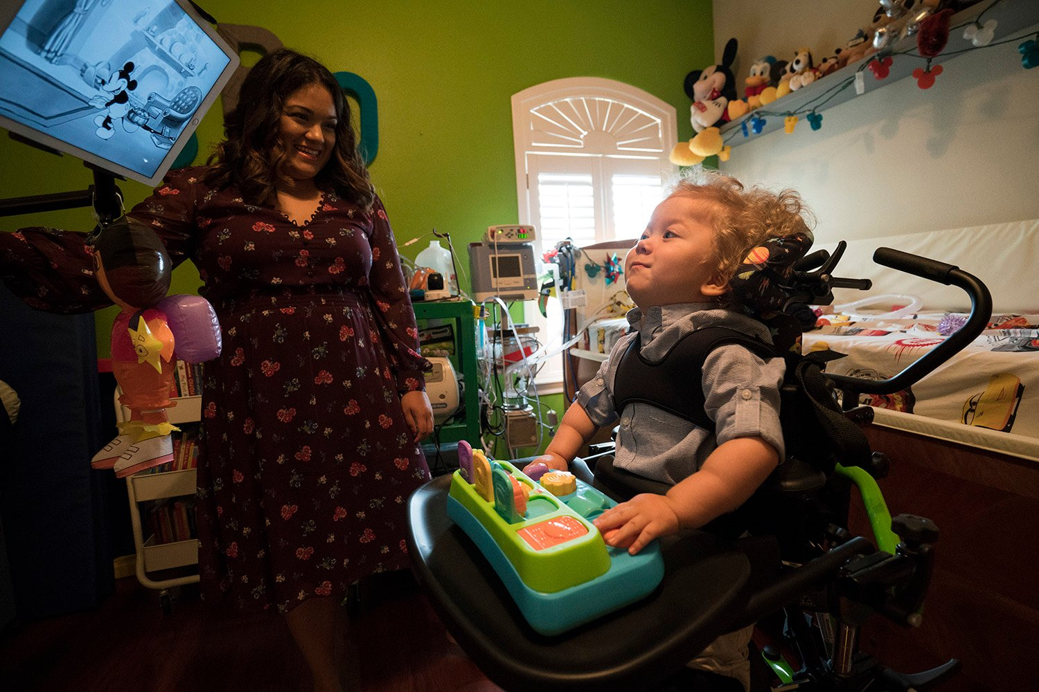 Jack Resendez watches cartoons from his pediatric standing frame. Though spinal muscular atrophy immobilizes children, it does not affect their ability to learn.