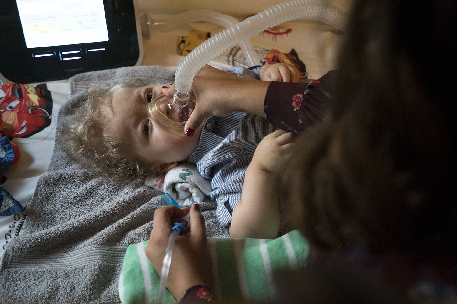 Kristen Resendez uses a suction and cough machine to help her son, Jack, breathe. Spinal muscular atrophy can weaken muscles, making simple tasks like breathing and chewing exhausting.