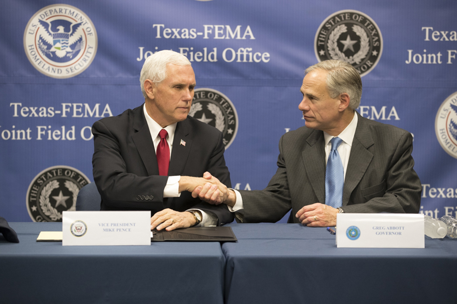 Vice President Mike Pence (left) and Gov. Greg Abbott at a briefing on post-Harvey recovery efforts at the Texas - FEMA Joint Field Office on Nov. 15, 2017.