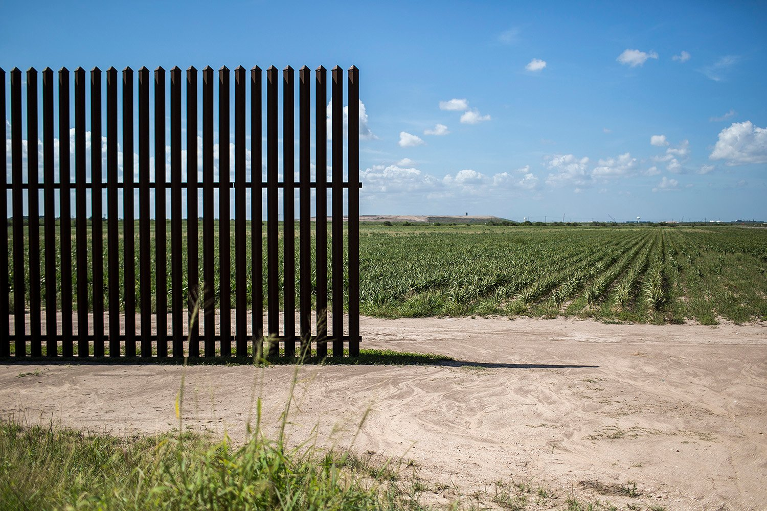 The end of a segment of the border fence near Oklahoma Avenue in Brownsville. To avoid paying for land trapped between the fence and the Rio Grande, the government left wide gaps so land owners could reach their fields.