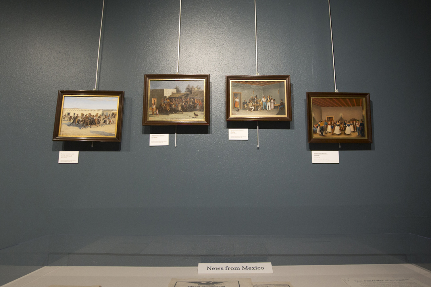 Scenes of early San Antonio painted by famous painter Theodore Gentilz hang on display in the Daughters of the Republic of Texas' new library.