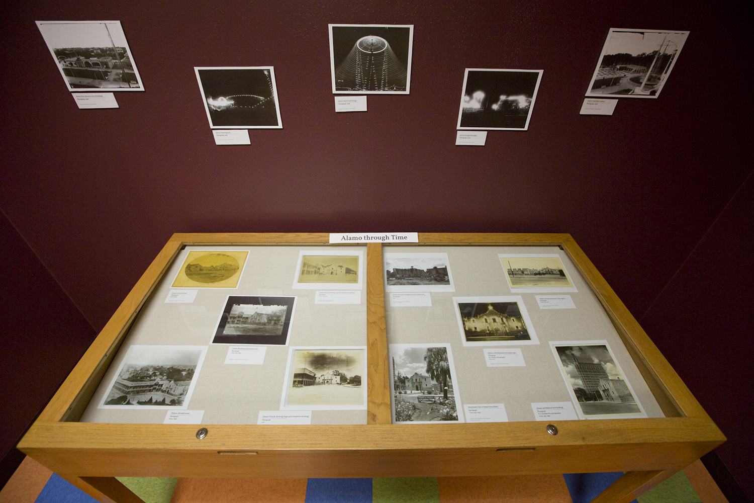 An exhibit in the Daughters of the Republic of Texas Library shows the Alamo through time.