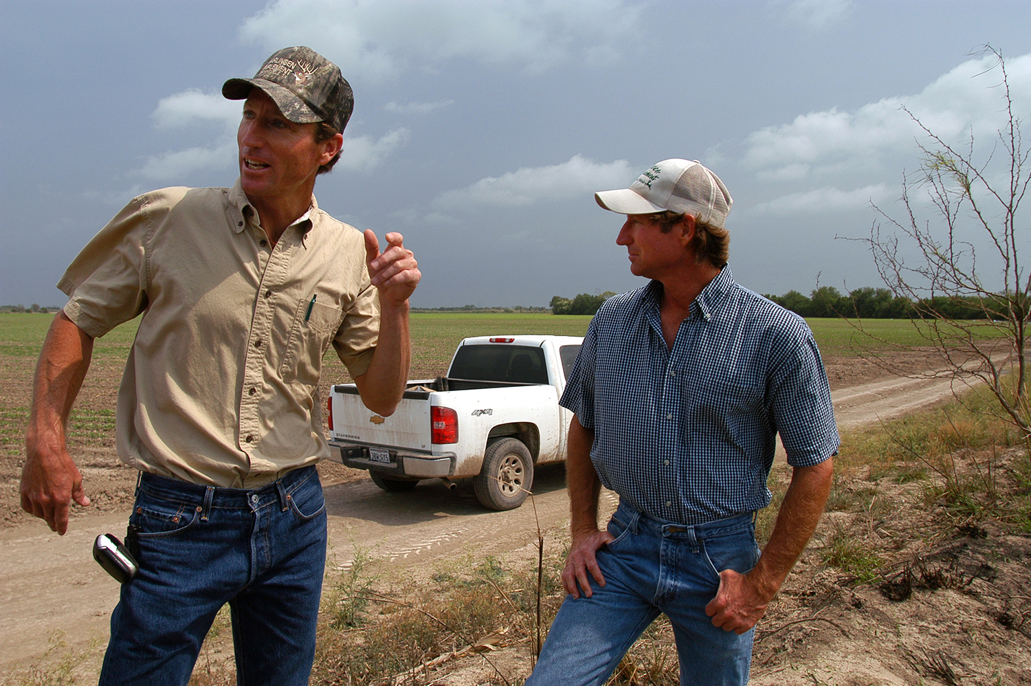 Paul and Tim Loop, seen here in April of 2008, before the border fence was built on part of their land.