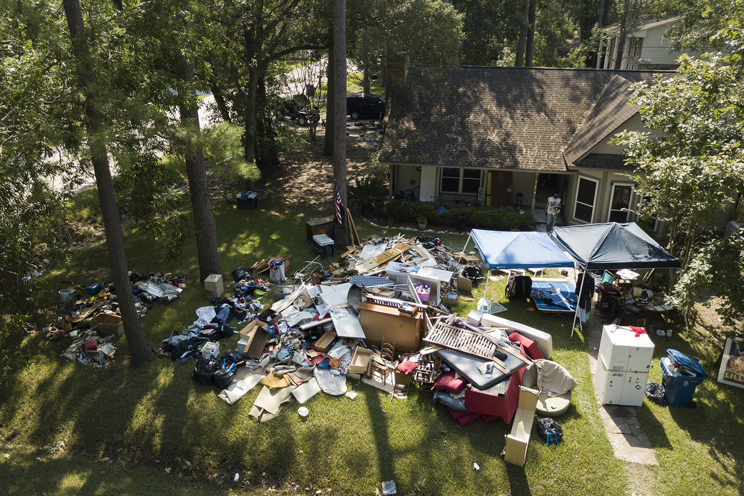 Houston ISD teacher Eric Thompson throws out debris and water-ruined possessions from his Dickinson home on Friday, Sept. 1, 2017.