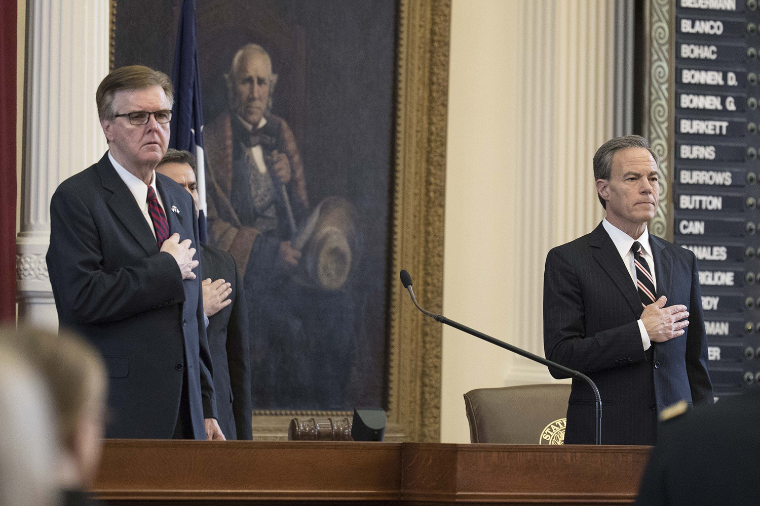Lt. Gov Dan Patrick (right) and House Speaker Joe Straus stand for a ceremony commemorating veterans on May 27, 2017, two days before the 85th Legislature adjourned sine die.
