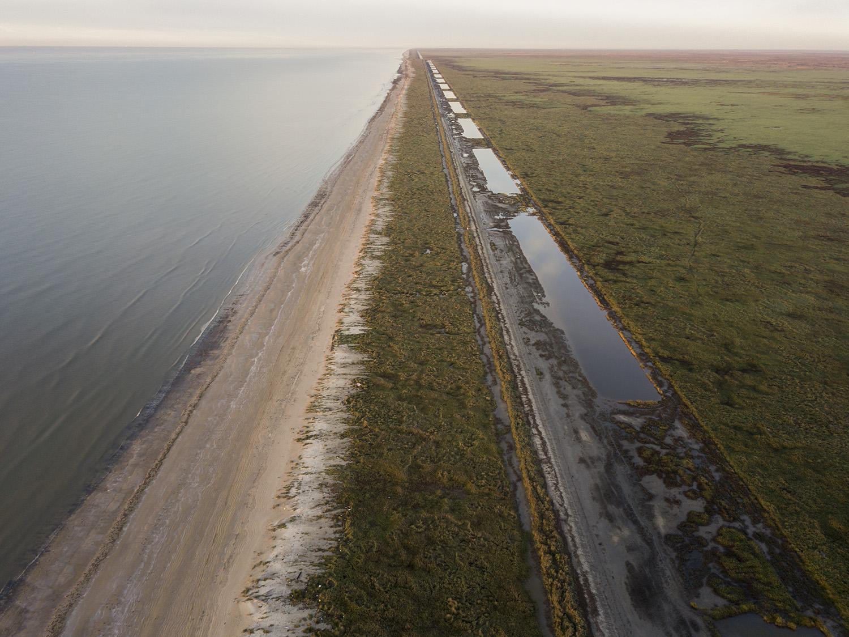 A new clay berm built to encourage sand dunes along the beach in McFaddin Wildlife Refuge near Port Arthur on Monday, Dec. 11, 2017.
