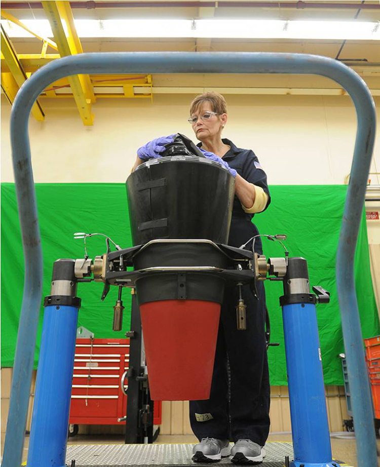 A production technician at the Pantex Plant works on a piece of equipment at the nuclear weapons facility. The Center for Public Integrity CPI interviewed six current and former Pantex workers about the new management. One said the plant-wide maintenance department was short 14 electricians, yet the contractor had hired six or seven managers instead.