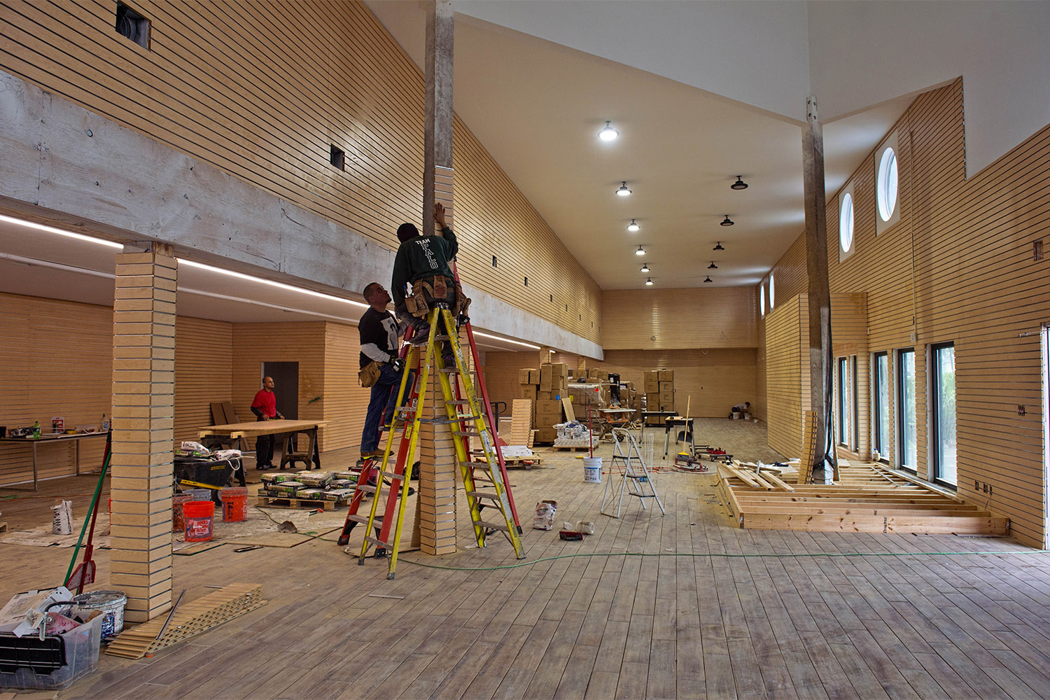 Workers prepare the interior of Third Coast Beach Co. in February 2018. The store was flooded with 31 inches of water when Hurricane Harvey hit. The owner is expecting to be open in 2 weeks.