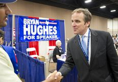 State Rep. Bryan Hughes shakes hands with a delegate at the trade show of the Texas Republican Convention June 8, 2012.