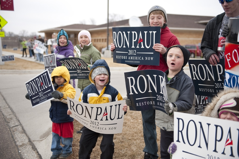 Young Ron Paul supporters gather outside the Sioux Center library to greet the Republican candidate on December 30, 2011.