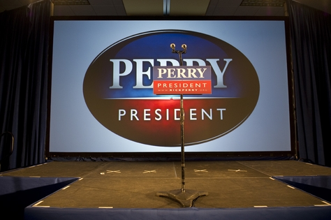 The empty stage at the West Des Moines Sheraton after Rick Perry announces that he'll return home to Texas to reassess his presidential campaign after finishing fifth in the Iowa caucuses on January 3, 2012.