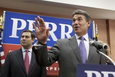 Rick Perry suspends his campaign for president with an announcement at the Hyatt Place in north Charleston, S.C. on January 19, 2012.