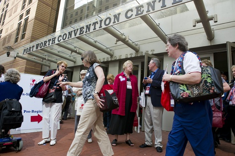 Texas Republican Convention delegates congregate outside the Fort Worth Convention Center on June 7, 2012.