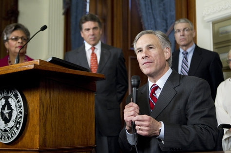 Attorney General Greg Abbott, Gov. Rick Perry, state Rep. Senfronia Thompson and Department of Public Safety chief Steve McCraw at the signing of House Bill 3000 on May 25, 2011.