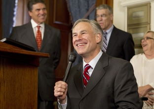 Attorney General Greg Abbott at a press conference after the ceremonial bill signing of human trafficking legislation on May 25, 2011.