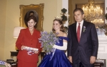 First Lady Laura Bush (l) and Governor George W. Bush (r) host the Texas Bluebonnet queen at the Governor's Mansion in April, 1997.