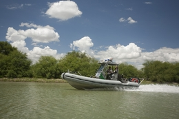 A U.S. Customs and Border Patrol boat heads south in the Rio Grande River between Hidalgo and Los Ebanos in Hidalgo County, TX on routine patrol August 25, 2007.  Texas lawmen engaged Mexican drug smugglers in a border gunbattle on June 9, 2011.