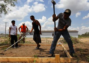 Juvenile detainees work on a new juvenile detention village in Eagle Pass. Maverick County has been taking donations for the new facility, which is being built, in part, by county employees who sacrifice their own time for the project.
