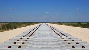 Concrete railroad ties are staged for the construction of the new Brownsville rail bridge.