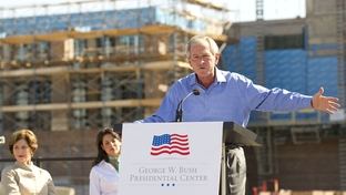 "Former President George W. Bush speaks at the ""topping out"" ceremony at the construction site of the George Bush Presidential Center at Southern Methodist University on October 3, 2011."